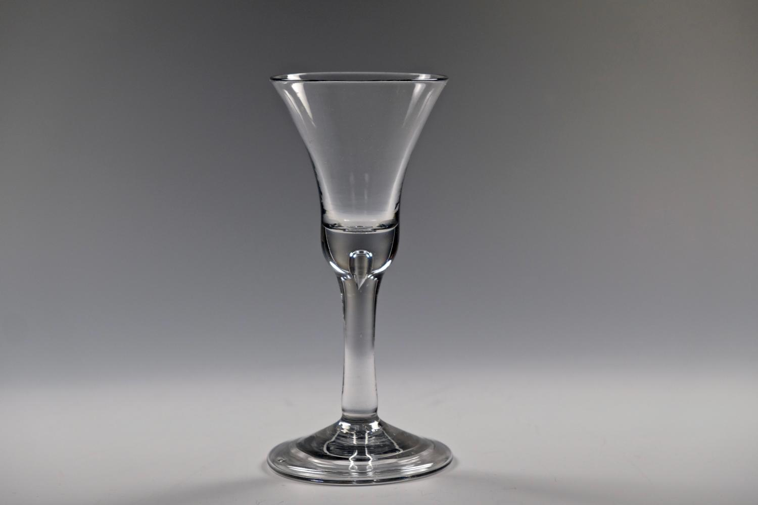 Plain stem wine glass with folded foot English C1750