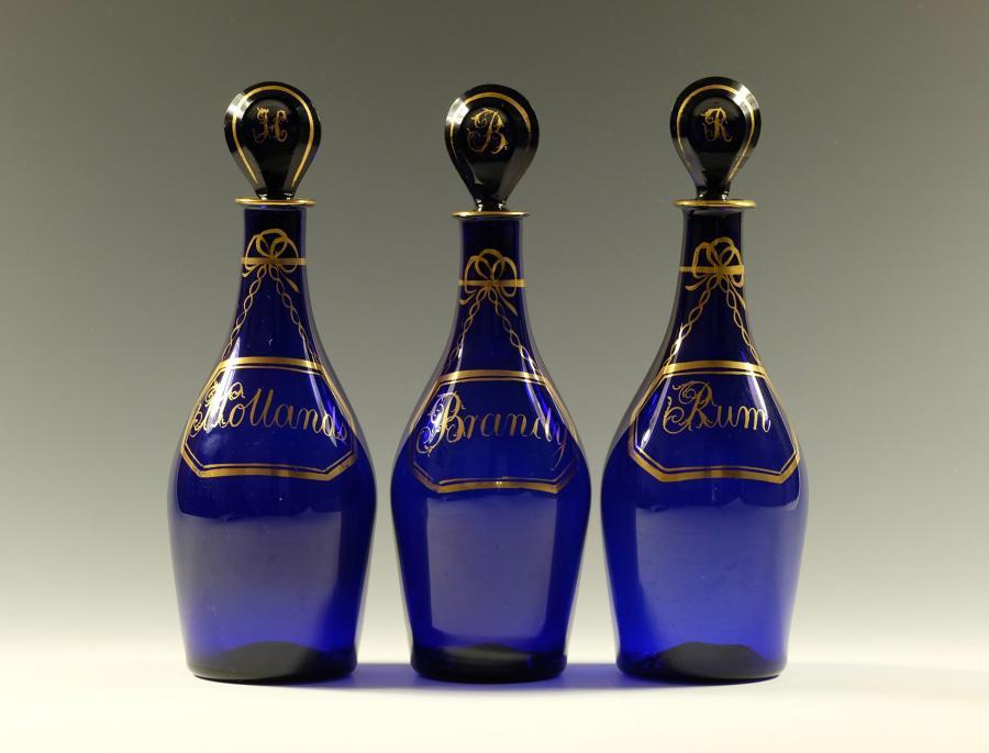 Set of three blue spirit decanters C1790