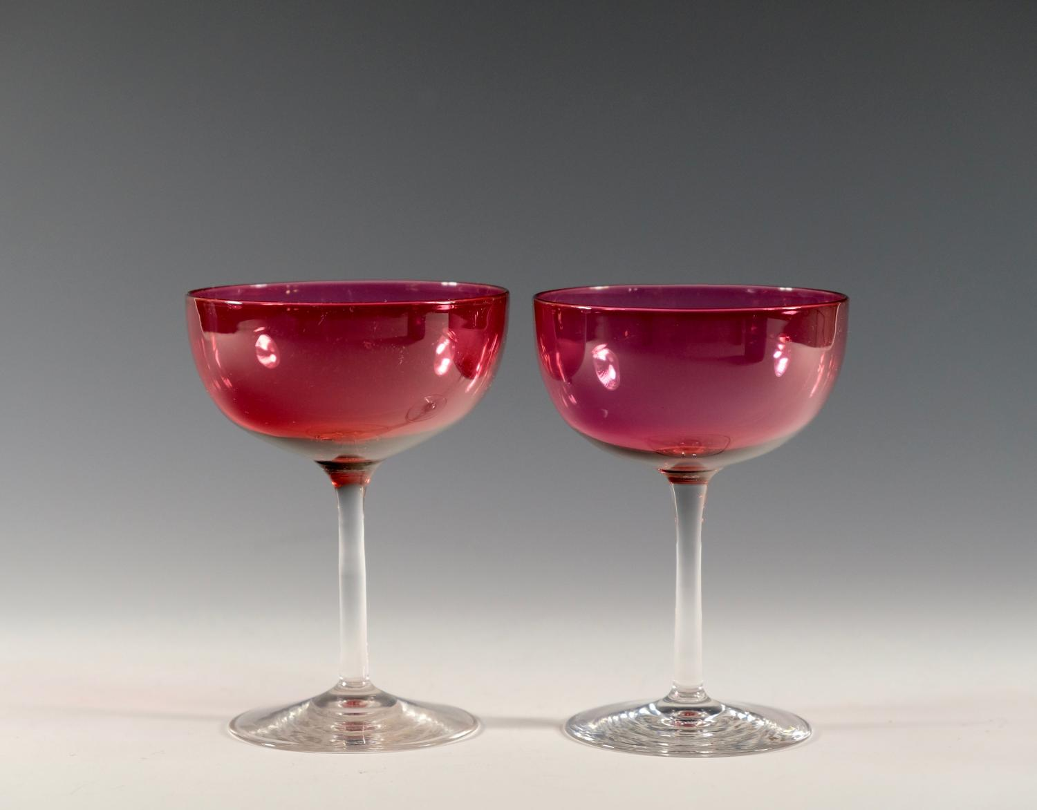 Pair of cranberry champagne glasses English C1880