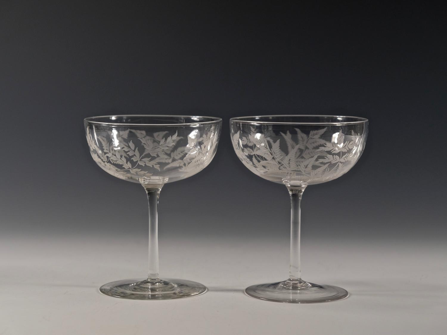 Pair of engraved champagne glasses C1880