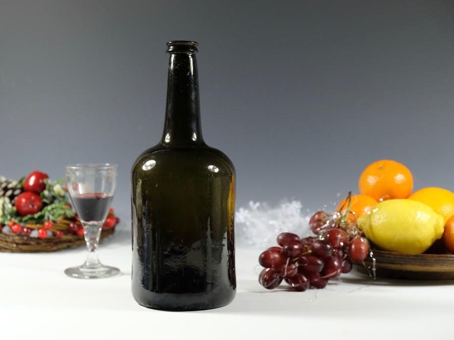 Dark green cylindrical wine bottle English C1760