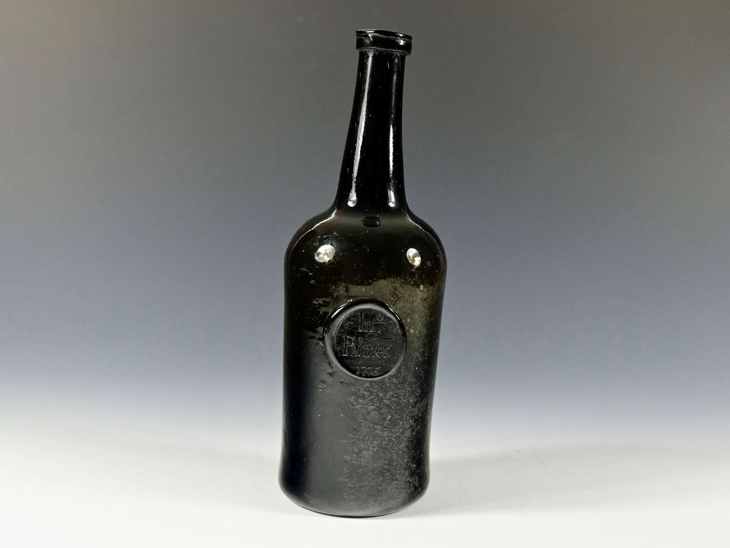 Sealed cylindrical wine bottle dated 1775