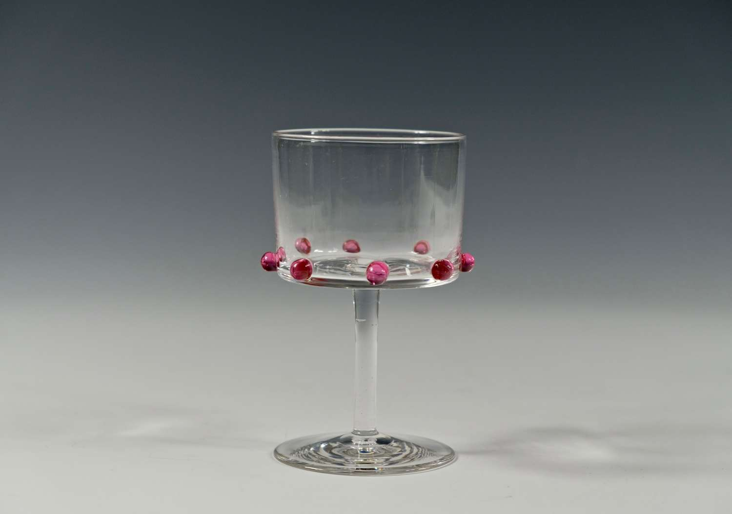 Rare wine glass with eight applied ruby prunts C1900