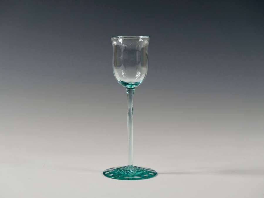 Liqueur glass in pale blue with twisted stem and optical ribbing C1900