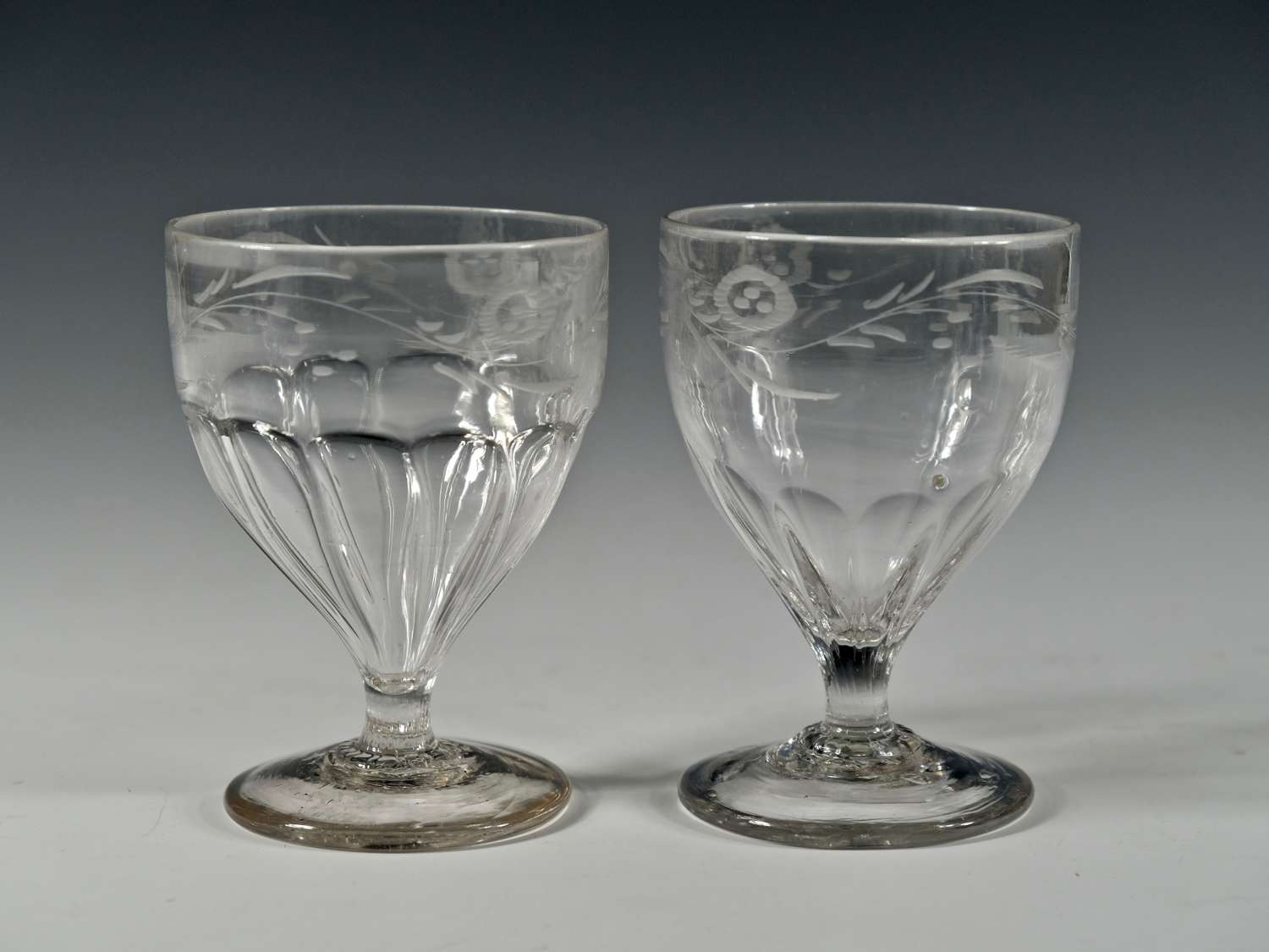 Near pair of engraved petal moulded rummers C1800