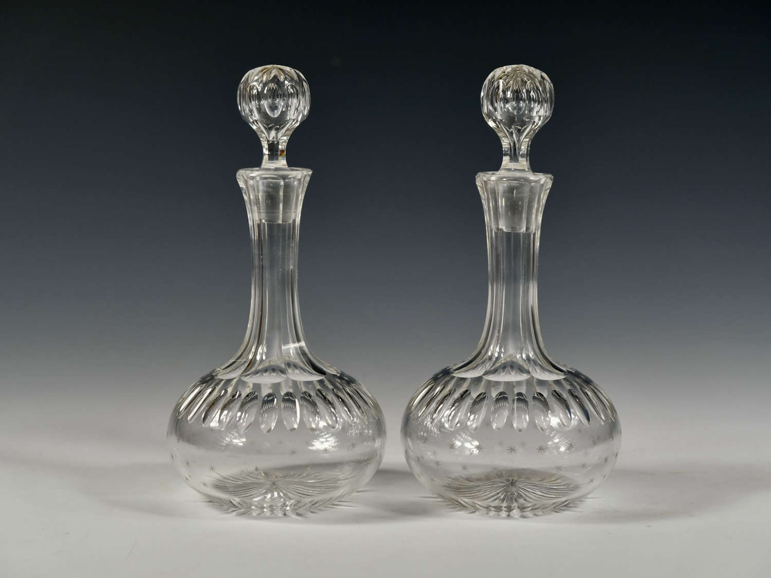 Pair of shaft and globe liqueur decanters C1880