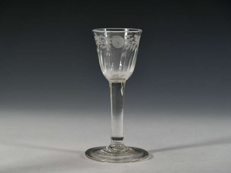 Plain stem wine glass with engraved bowl c1760