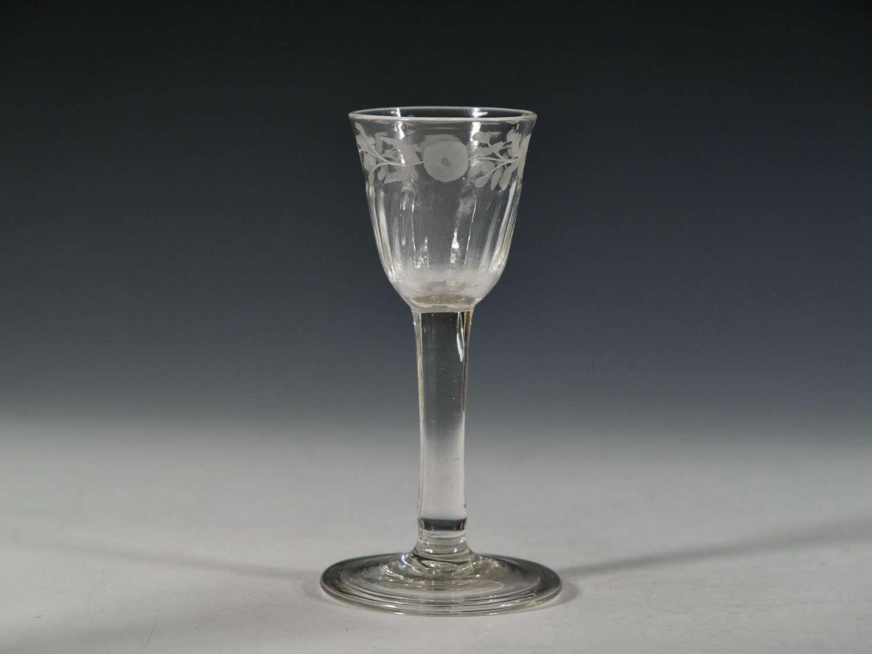 Plain stem wine glass with engraved bowl c1760