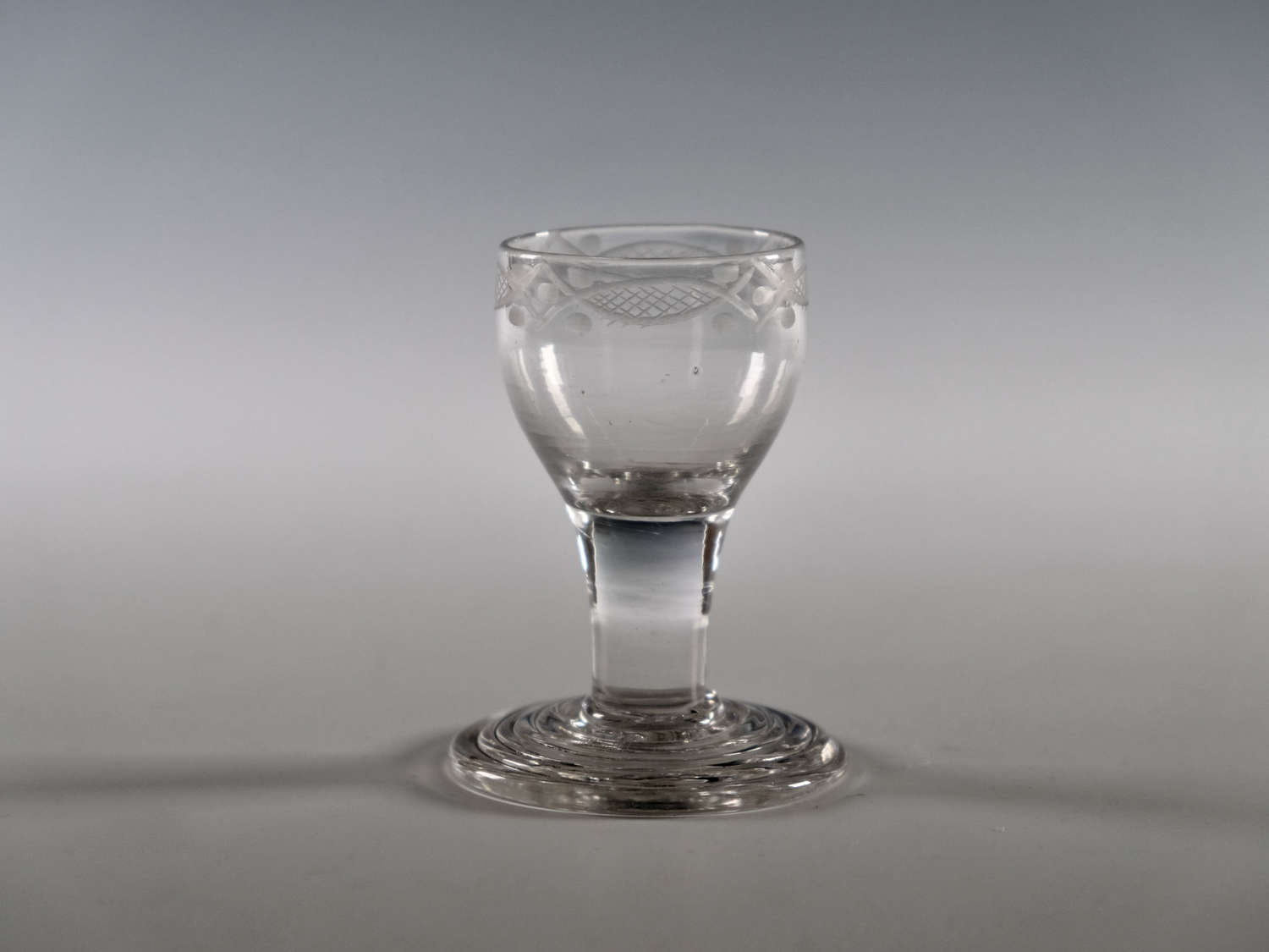 Dram glass with terraced foot English c1760
