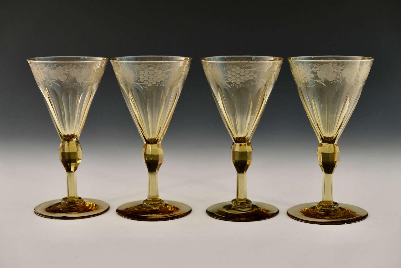 Four engraved amber wine glasses English c1840/50