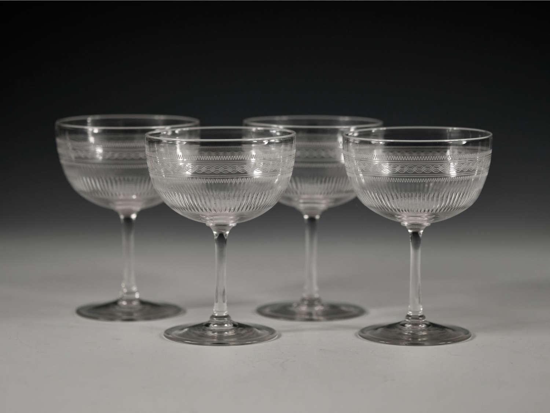 Four champagne glasses English c1900