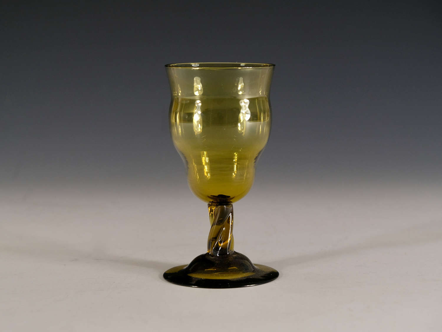 Antique wine glass by Philip Webb