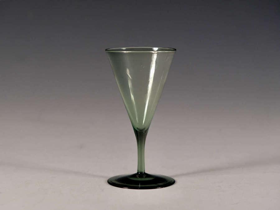 Antique glass dark green Harry Powell Whitefriars c1880